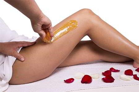 como depilar las piernas con cera caliente