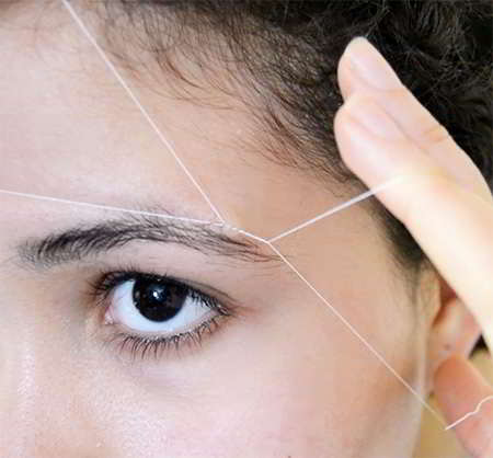 como depilarse las cejas con hilo