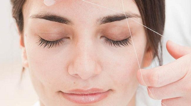 como depilar la cara con hilo